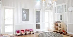 White playroom with pinstripe walls