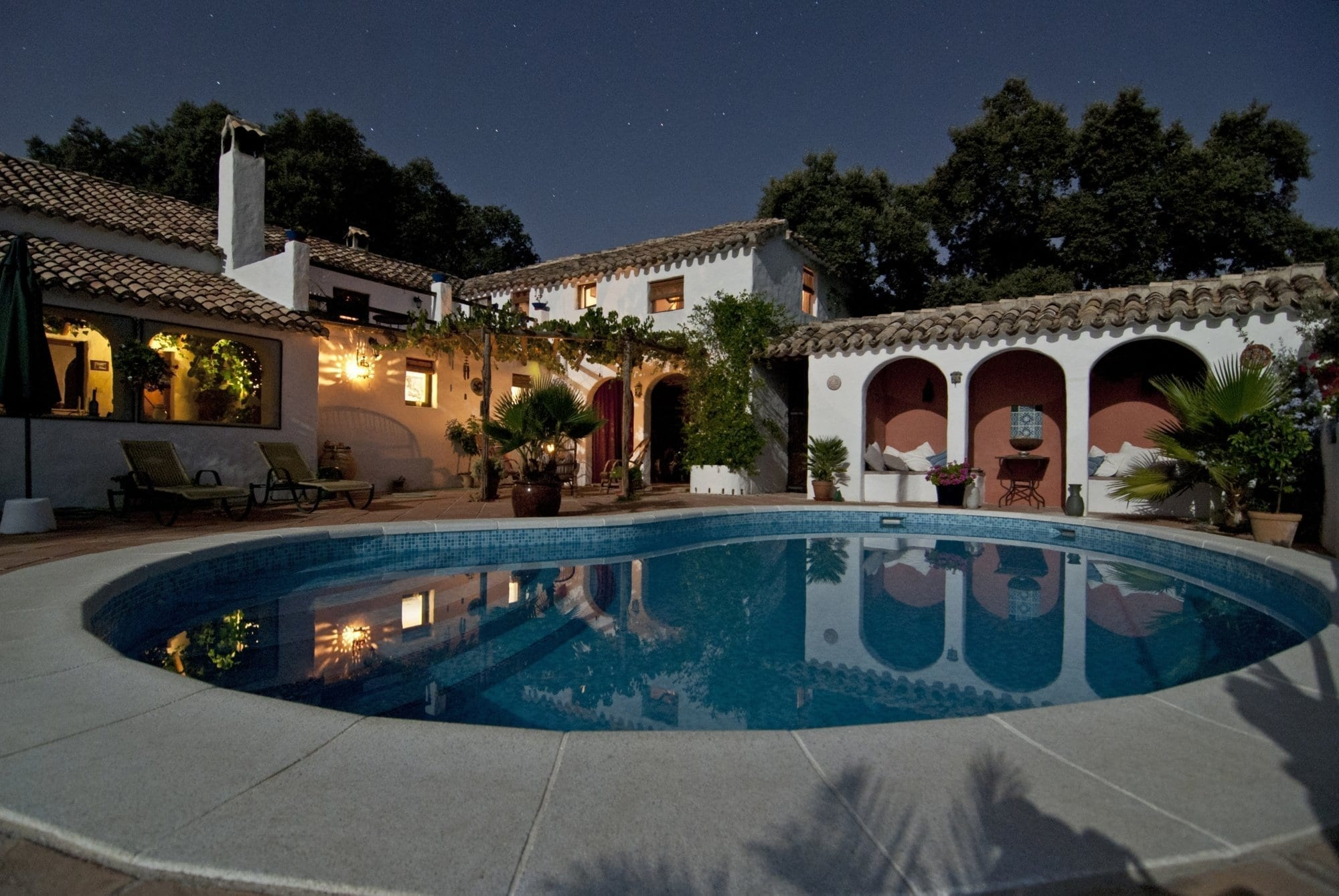 Residential exterior painted stucco with pool
