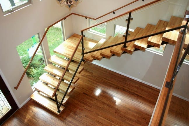 Modern painted home with stained wood stairs