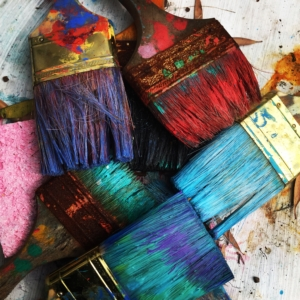 Paint brushes with rainbow of colors