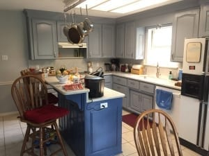 Kitchen Cabinet Painting with blue island and gray cabinets