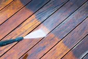 Powerwash the deck before testing the new stain color