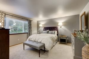 master bedroom with accent wall