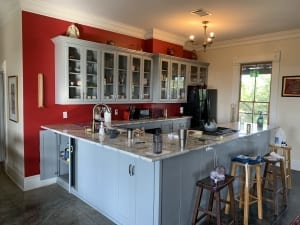 gray painted kitchen cabinet with red wall