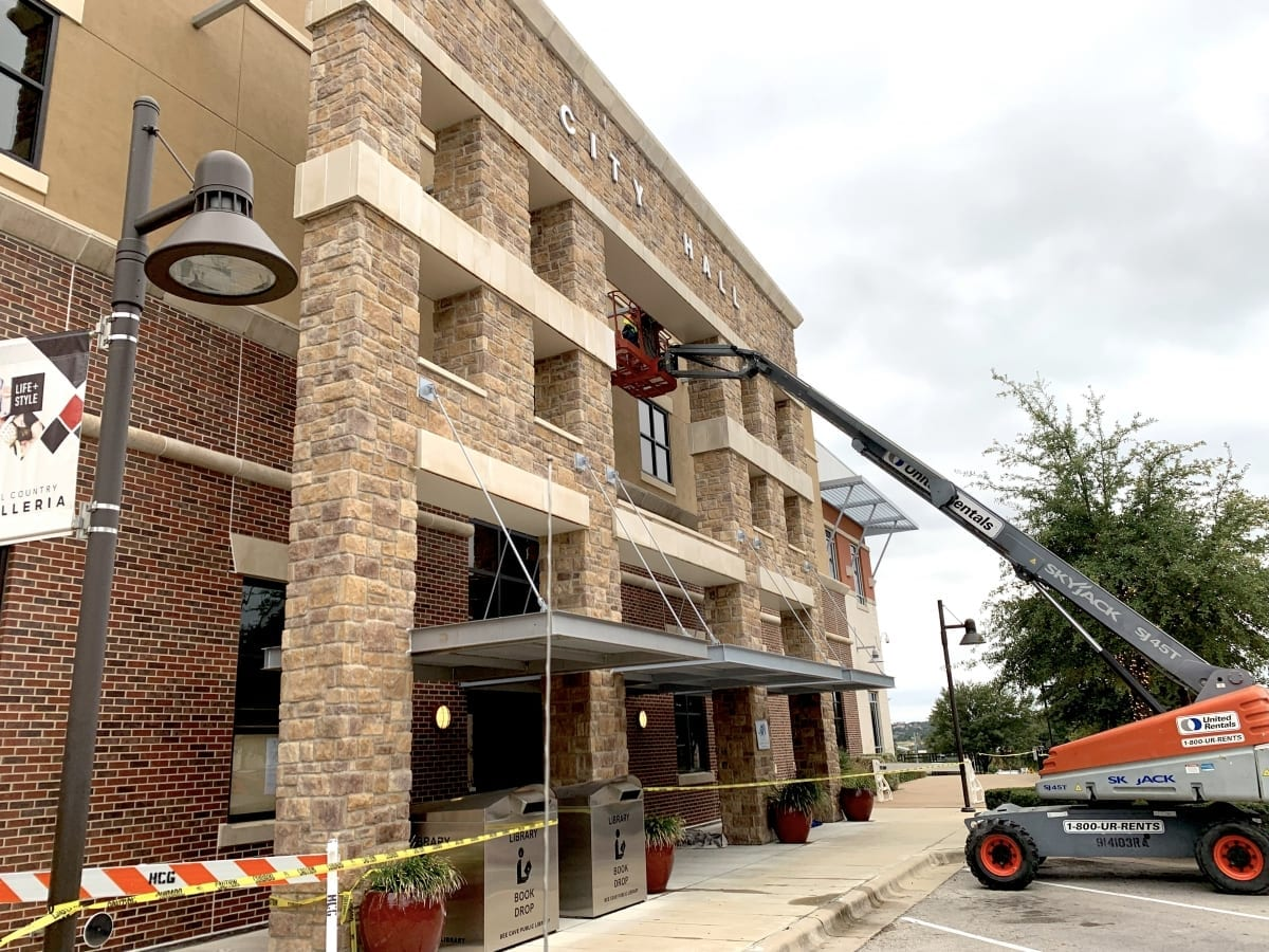Painting exterior lintels at Bee Cave City Hall