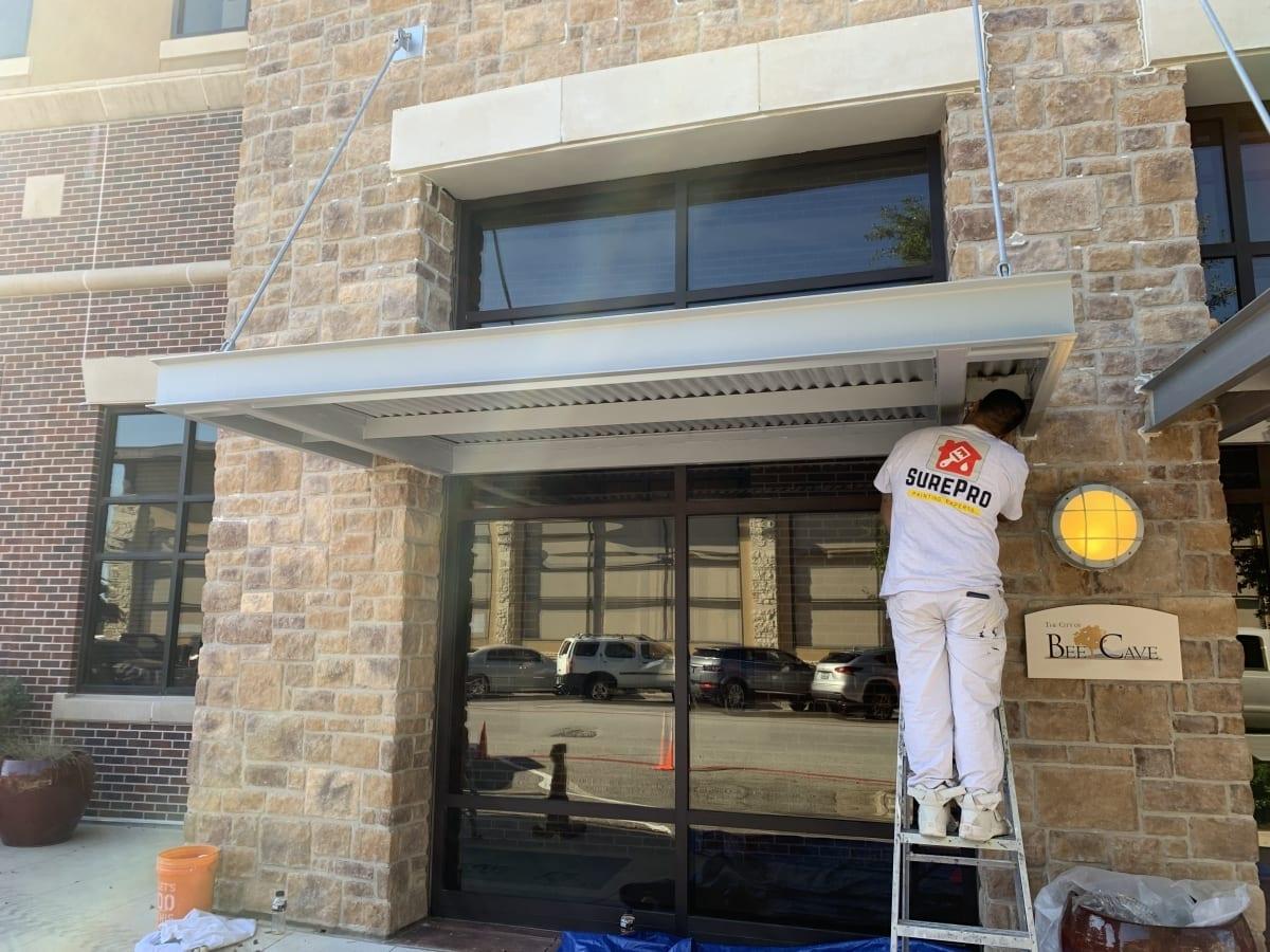 SurePro painter painting metal awning