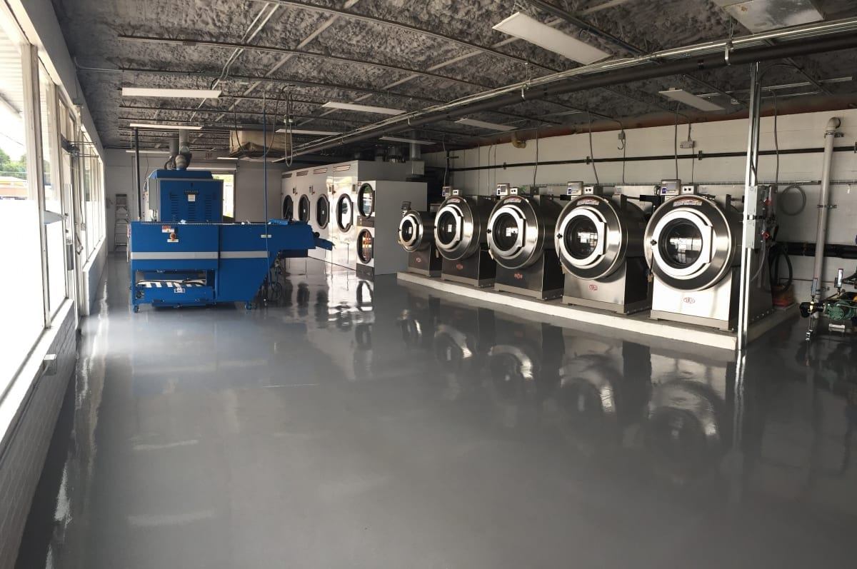 commercial laundry interior white painted masonry and epoxy floor