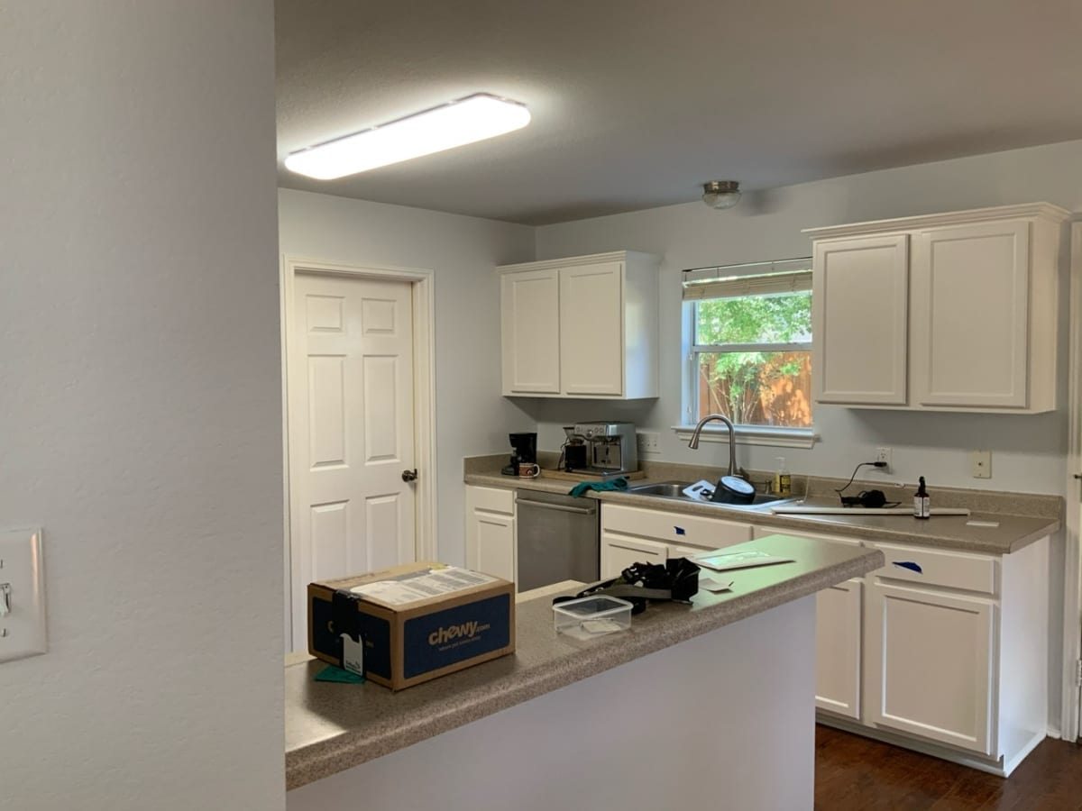 gray kitchen with painted white cabinets