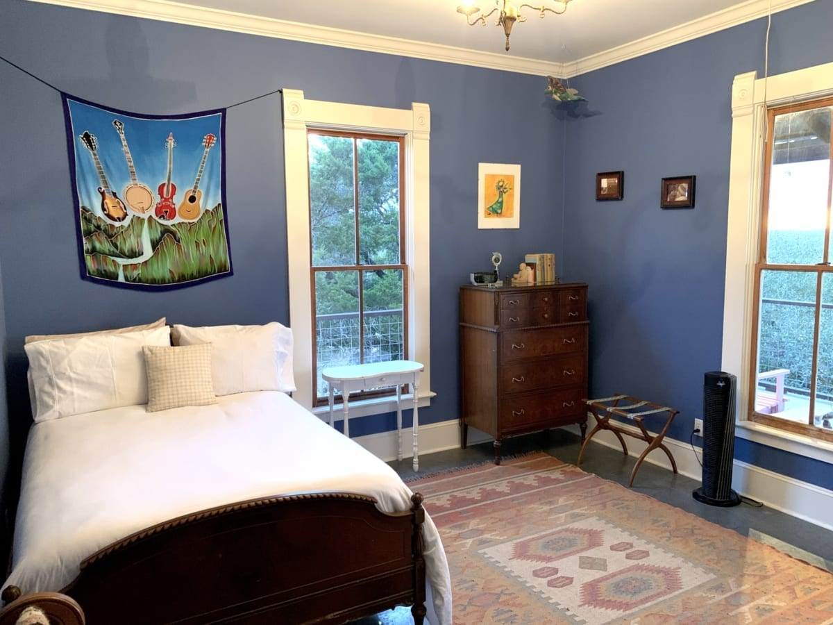 blue bedroom with white trim