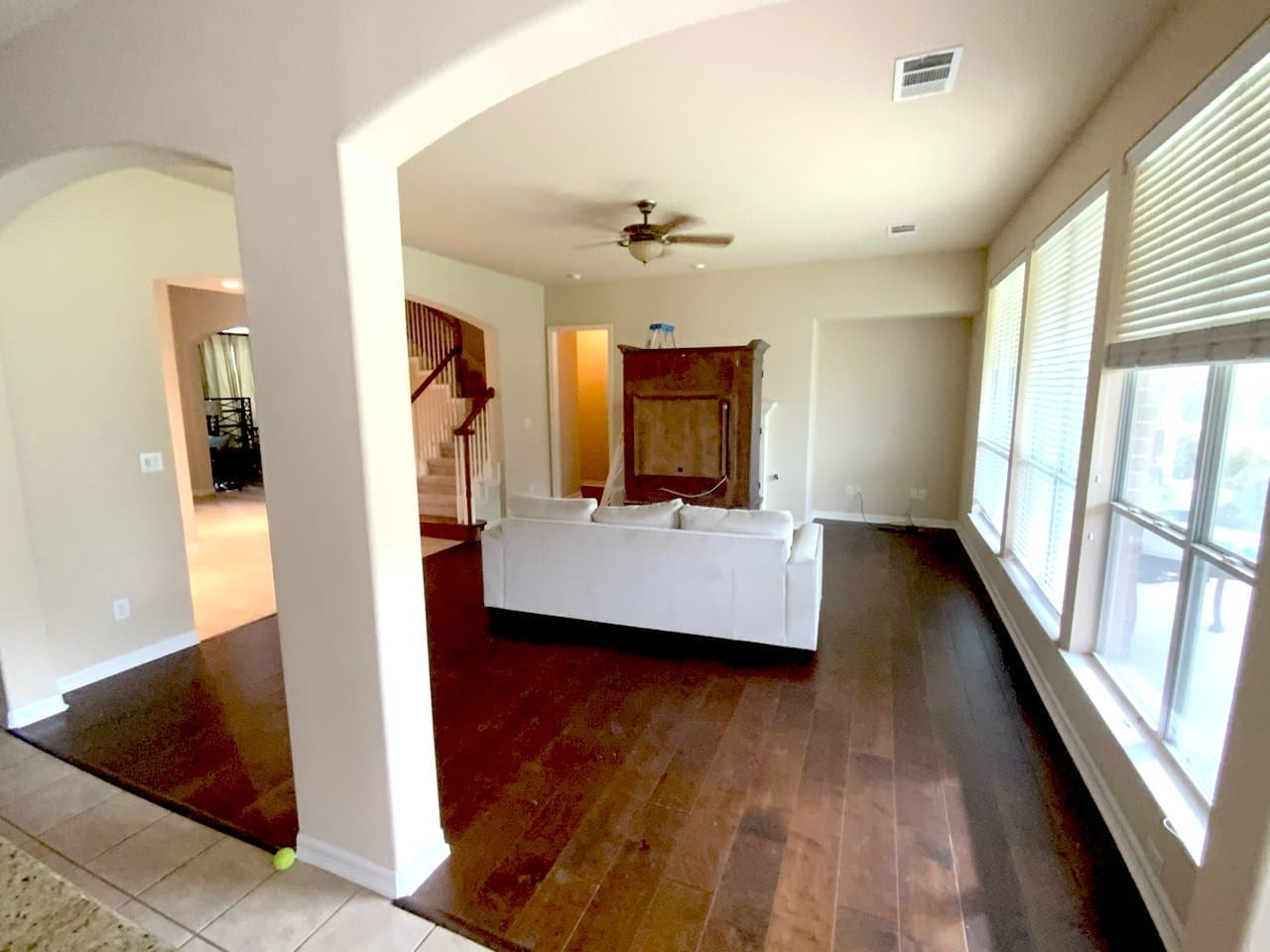 painted beige living room with wood floors