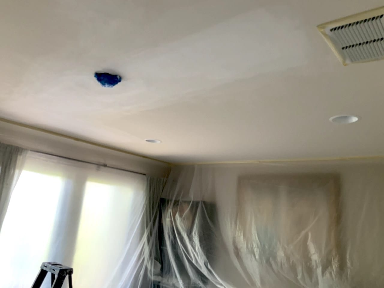 room masked before spraying new ceiling texture